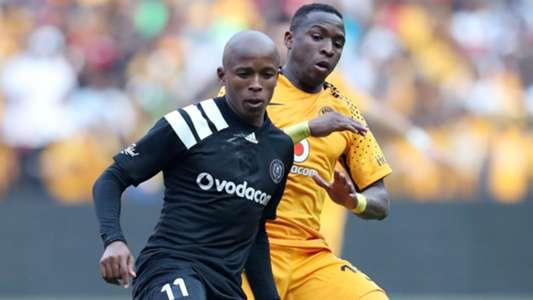Luvuyo Memela of Orlando Pirates challenged by George Maluleka of Kaizer Chiefs