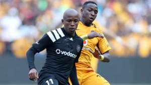 Luvuyo Memela of Orlando Pirates challenged by George Maluleka of Kaizer Chiefs