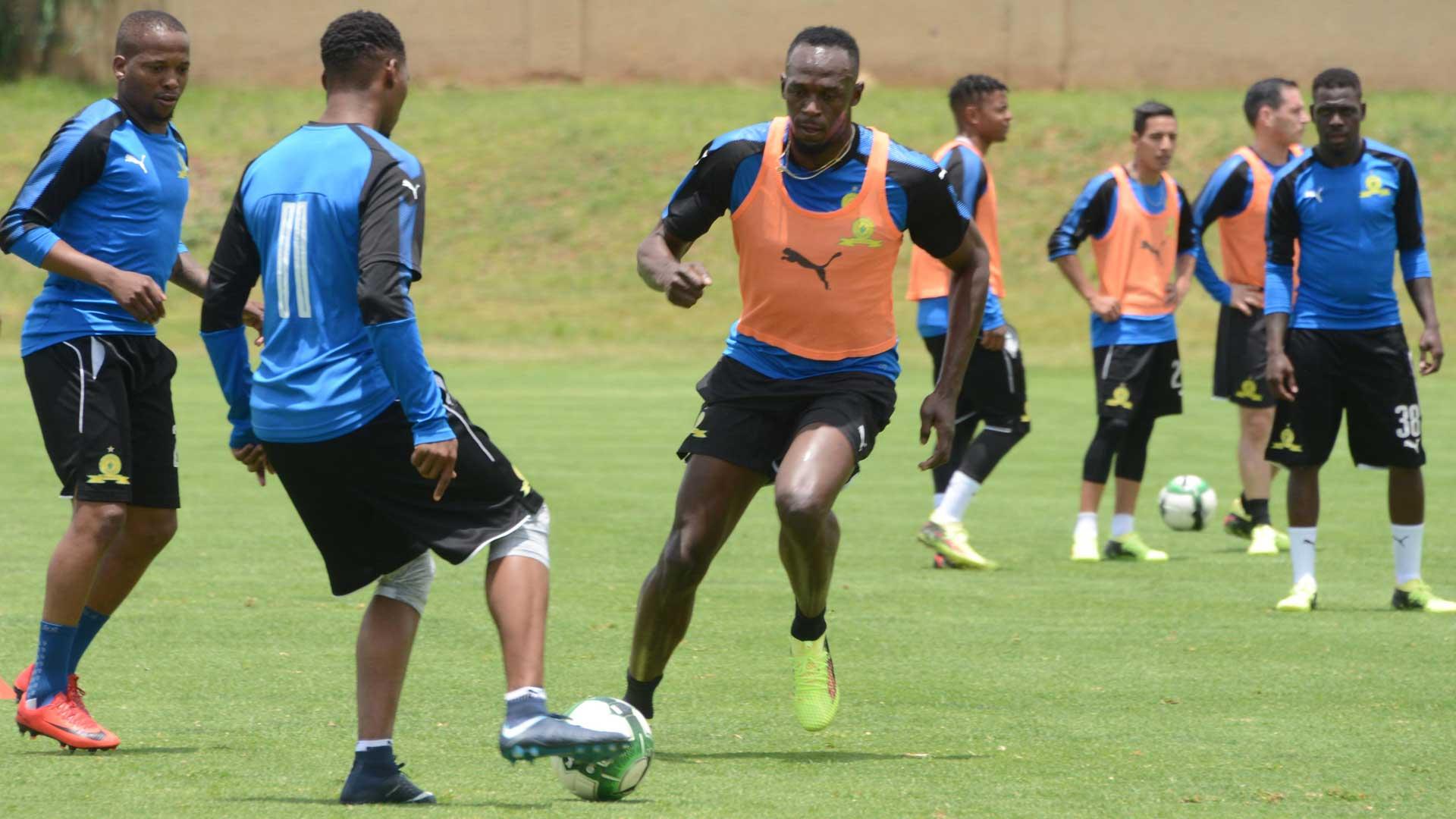 Usain Bolt vs Robbie Williams em jogo de futebol solidário