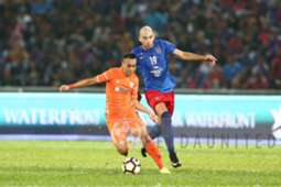 Felda United's Norshahrul Idlan Talaha (left) vies for the ball with Johor Darul Ta'zim'sJerónimo Barrales 27/1/2017