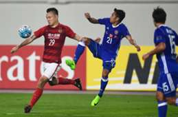 Gao Lin (L) of Guangzhou Evergrande competes for the ball with Tsang Kam To (C) of Eastern FC during their AFC Champions League group stage football match in Guangzhou