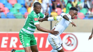 Thabang Monare of Bidvest Wits challenged by Ndumiso Mabena of Bloemfontein Celtic