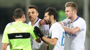Inter players contest Fiorentina penalty