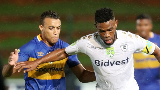 Thulani Hlatshwayo of Bidvest Wits challenged by Matthew Rusike of Cape Town City
