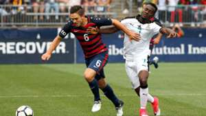David Accam of Ghana, USA's Kelyn Rowe