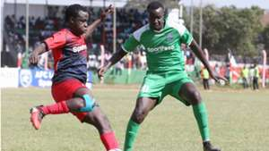 Gor Mahia midfielder Humphrey Mieno v Collins Okoth of AFC Leopards.