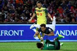 Johor Darul Ta'zim's Aidil Zafuan goes flying under a challenge by his own goalkeeper as Kedah's Ken Ilso Larsen looks on 20/1/2017