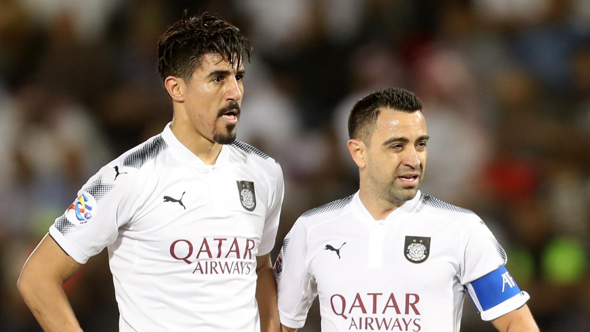 Bounedjah and Xavi Hernandez, in a Al Sadd game