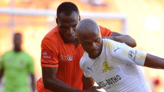 Rodney Ramagalela of Polokwane City challenges Tebogo Langerman of Mamelodi Sundowns