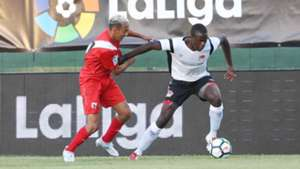 Vincent Oburu ® tackled by Bilal Boutobba of Sevilla