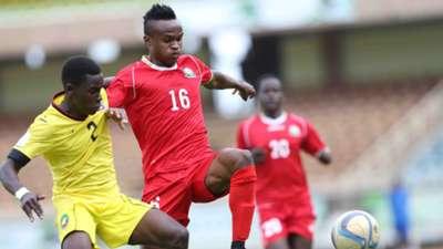 Clifton Miheso of Kenya and Harambee Stars tackle Bhehu Jamuacio.