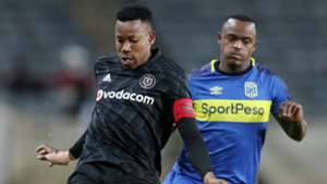 Happy Jele of Orlando Pirates clears ball from Ayanda Patosi of Cape Town City, September 2018