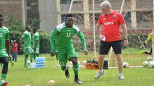 Harambee Stars coach Paul Put and George Odhiambo of Gor Mahia.