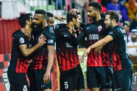 Al-Ahli players celebrate their goal during the AFC Champions League qualifying football match between UAE's Al-Ahli and Iran's Esteghlal FC