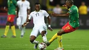 Ghana's midfielder Mubarak Wakaso is marked by Cameroon's forward Karl Toko Ekambi during the 2019 Africa Cup of Nations