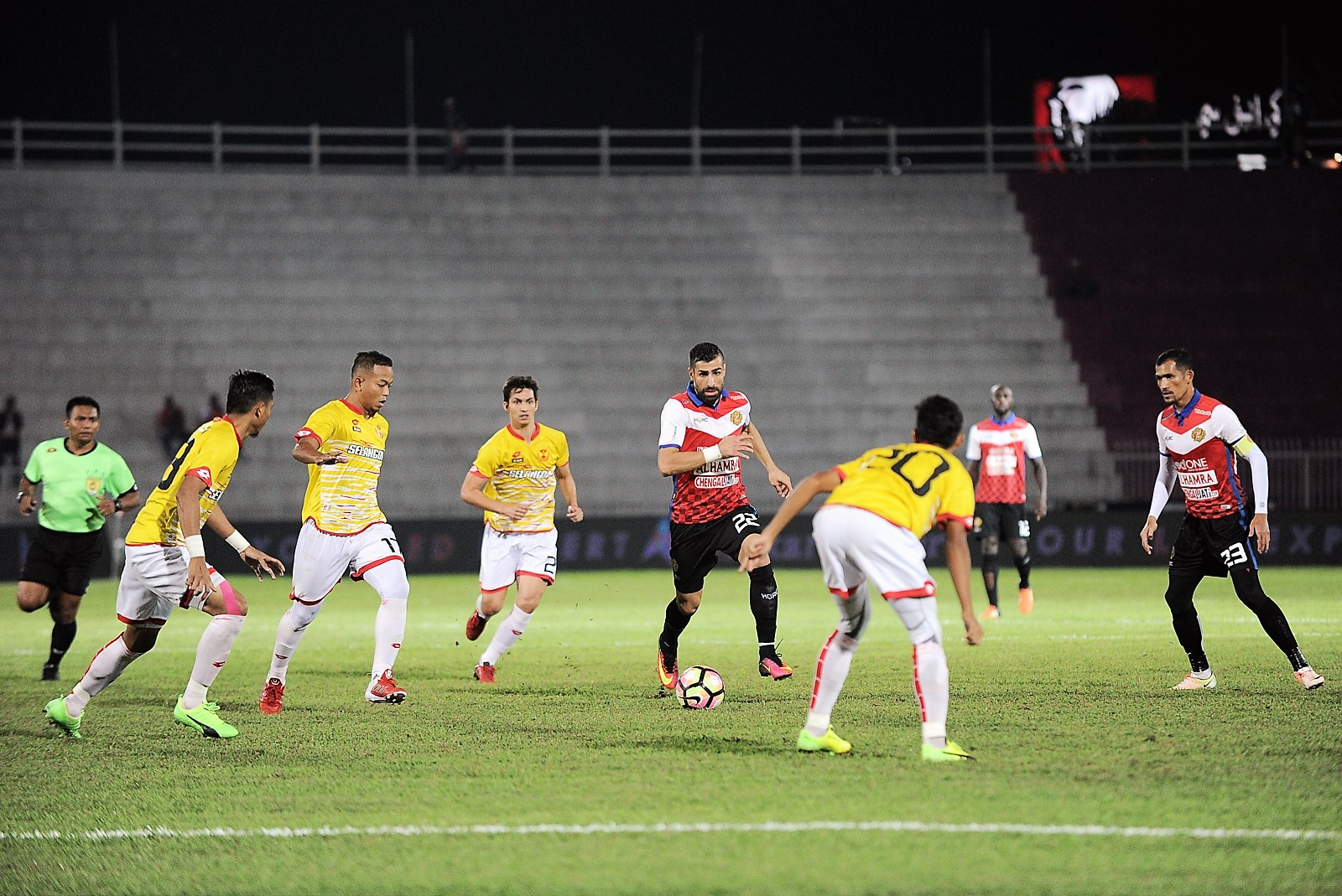 Kelantan's Mohammed Ghaddar (middle, in red) tries to dribble past Selangor players 25/2/2017
