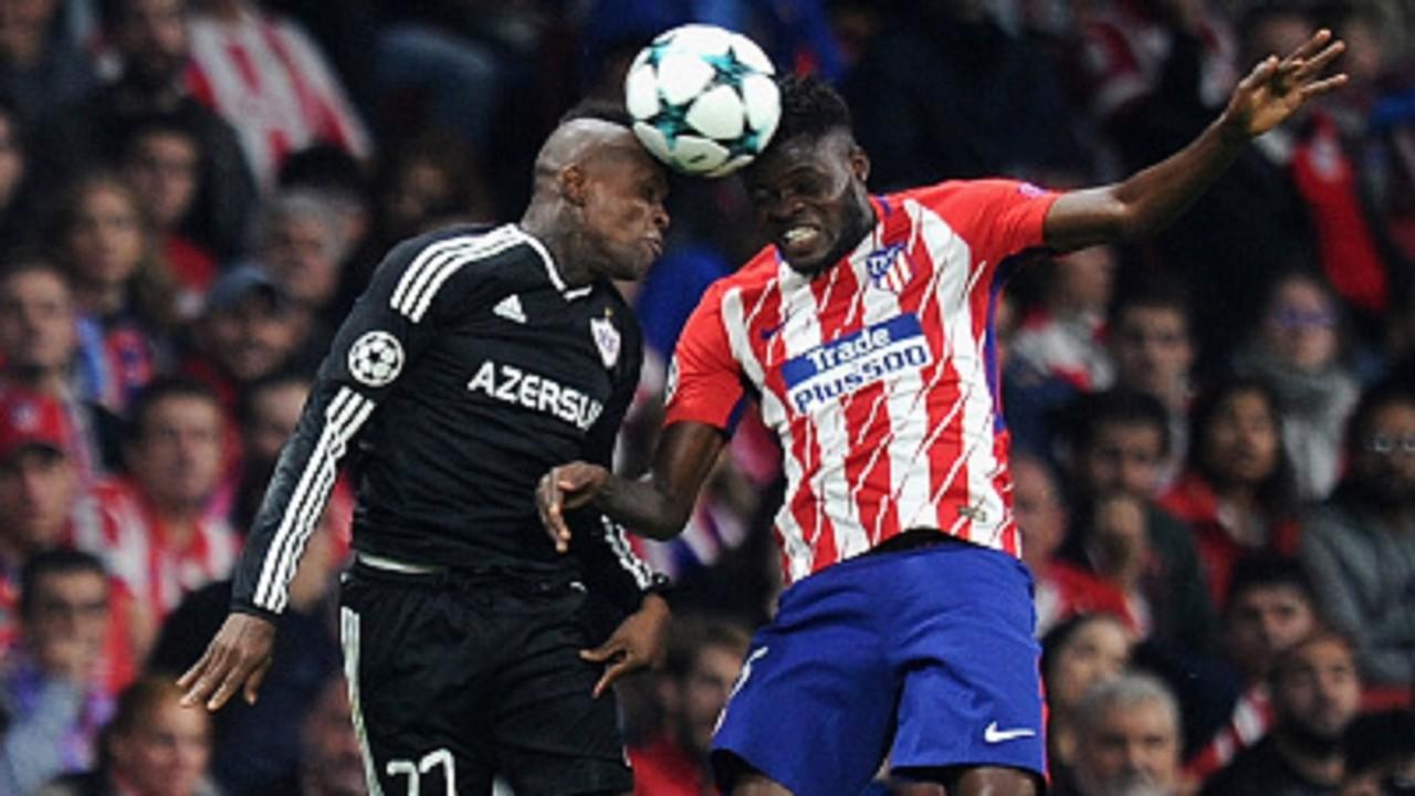 Elshan Abdullayev of Qarabag FK and Thomas Partey of Atletico Madrid during the UEFA Champions League