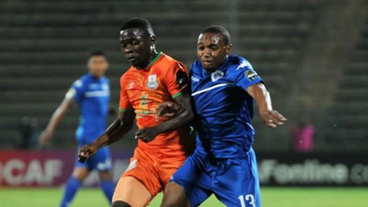 Thuso Phala of Supersport United challenges Dave Daka of Zesco United