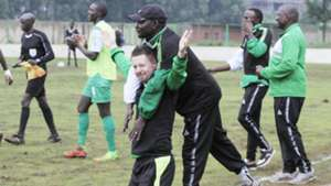Gor Mahia coach Dylan Kerr and Zedekiah Otieno