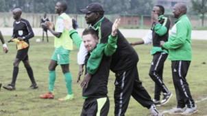 Gor Mahia coach Dylan Kerr and Zedekiah Otieno
