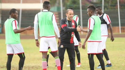 Aboud Omar and Harambee Stars coach Sebastien Migne.