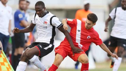 Vincent Oburu (L) tackled by Jose Alonso