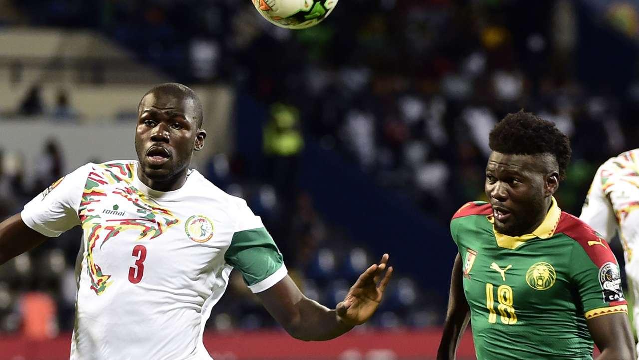 Kalidou Koulibaly of Senegal & Robert Ndip Tambe of Cameroon