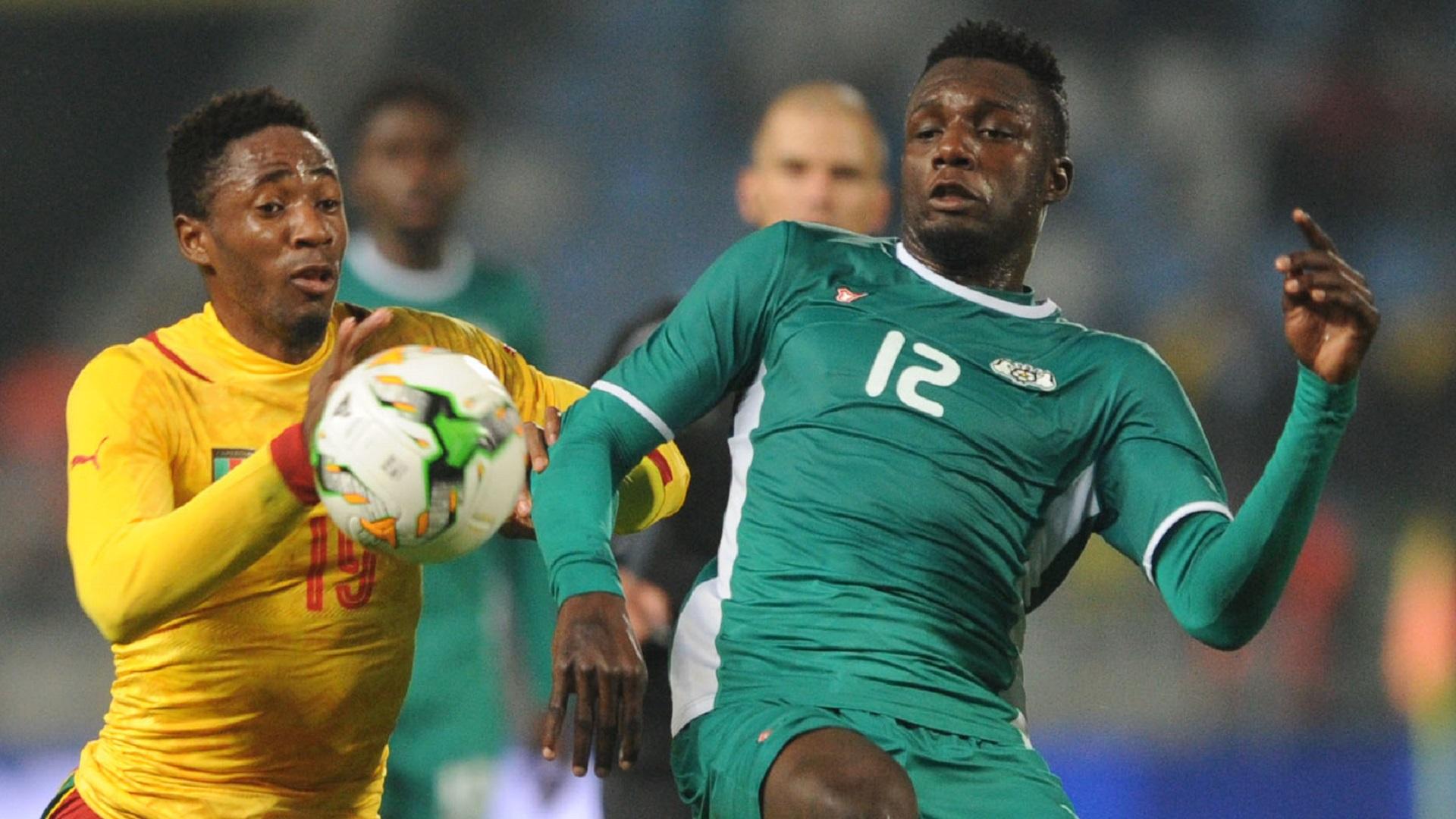 Raphael Eric Messi Bouli of Cameroon and Abdoul Abass Guiro of Burkina Faso