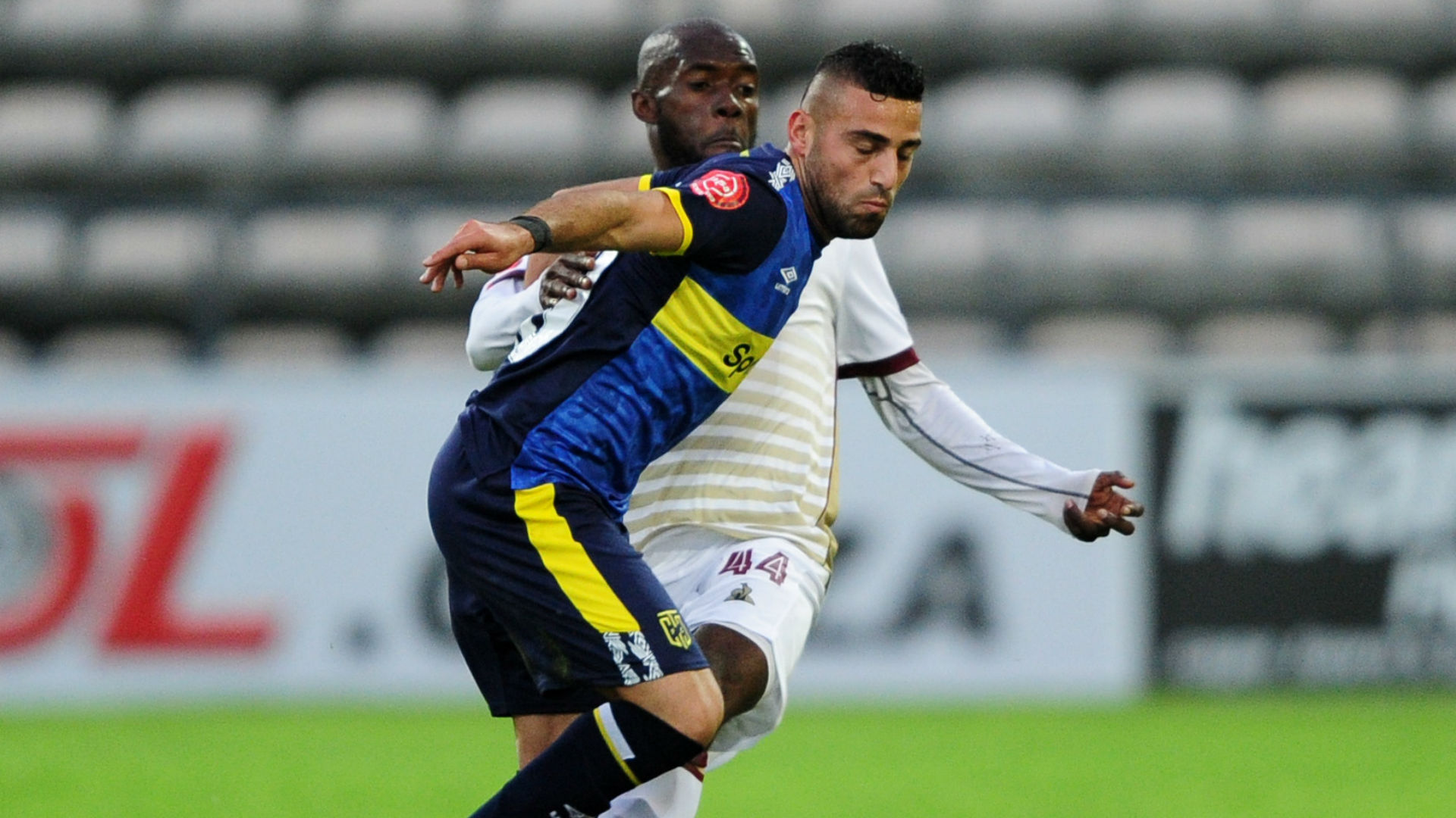 Christopher David of Cape Town City is challenged by Junior Awono of Stellenbosch FC, August 2019