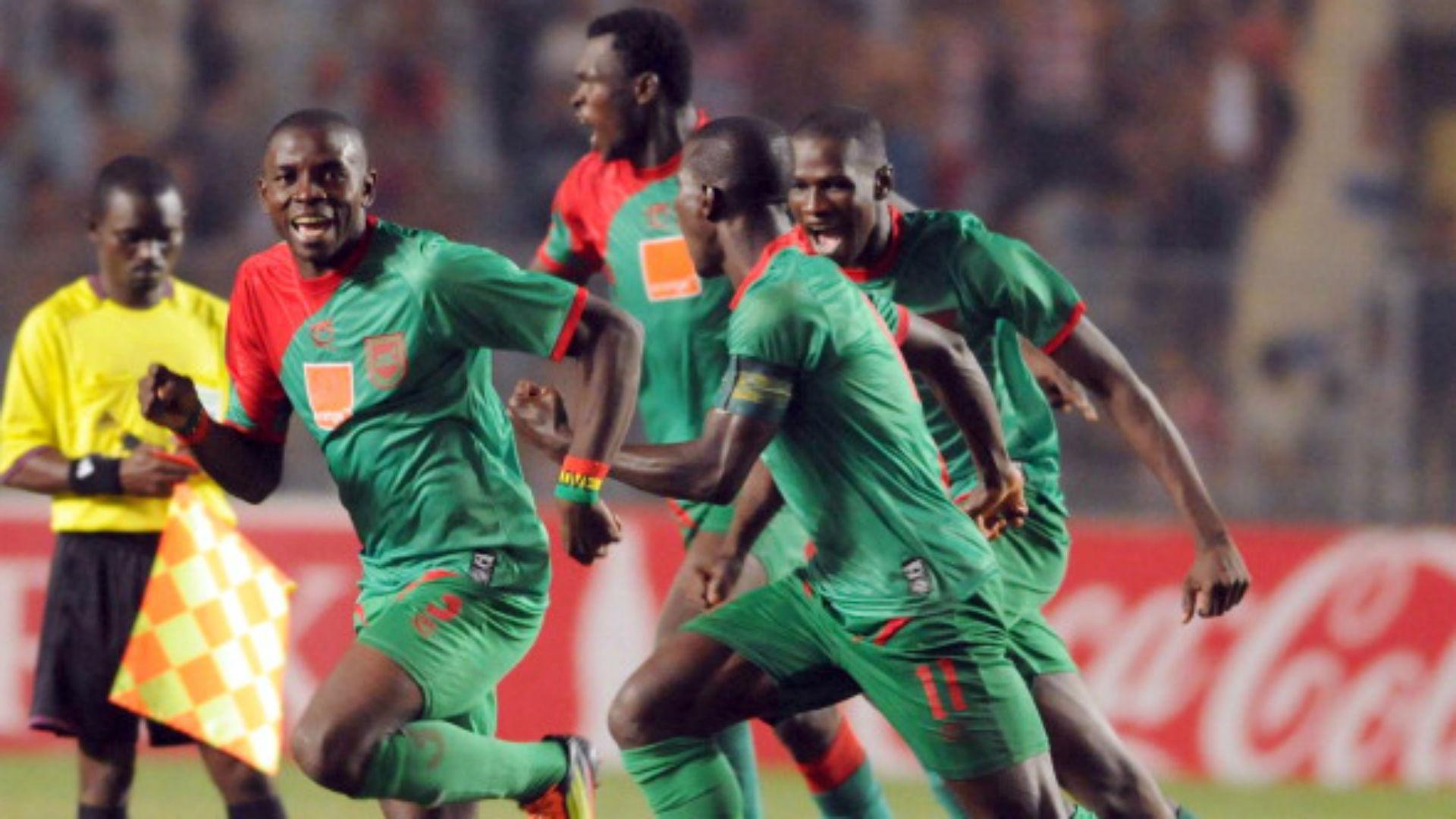 Malian Djoliba A C striker Alou Bagayoko (L) celebrates with teammates