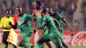 Malian Djoliba A C striker Alou Bagayoko (L) celebrates with teammates