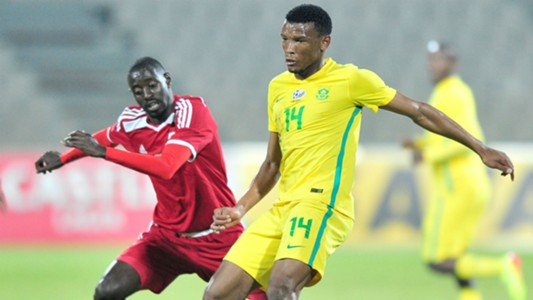Mothobi Mvala of South Africa challenged by Deon Hotto of Namibia