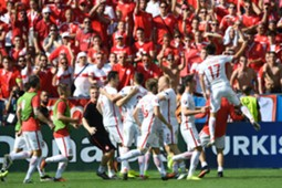 Poland players cerebrate in front of Swiss fans