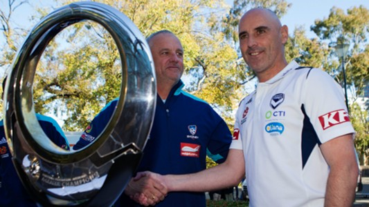 Graham Arnold/ Kevin Muscat
