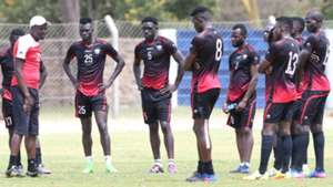 Harambee Stars coach Stanley Okumbi with the players.