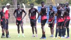 Harambee Stars coach Stanley Okumbi with the players.