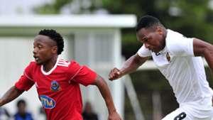 Mpambaniso Monde of Tshakhuma Tsha Madzivhandila pulls away from Mlungisi Mbunjana of Cape Town All Stars