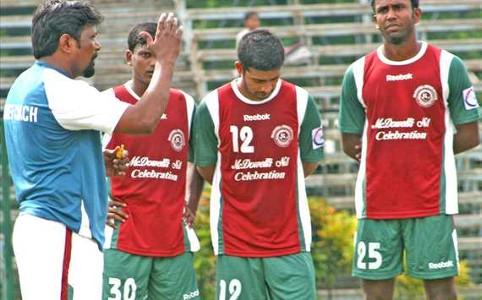 Ashim Biswas (centre)