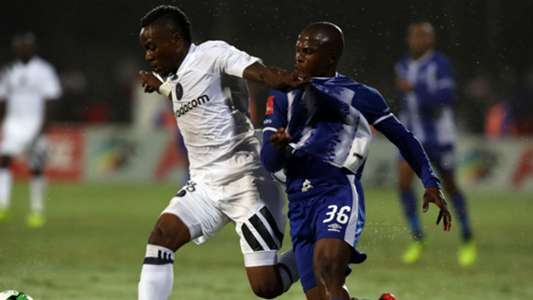 Mthokozisi Dube of Orlando Pirates holds off Mxolisi Kunene