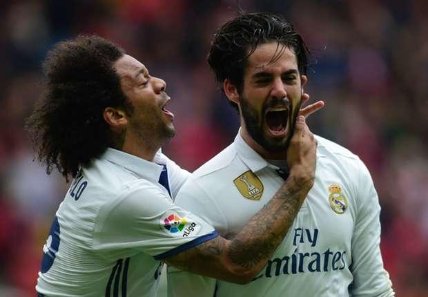 Marcelo ikut gembira setelah Isco mencetak tembakan kemenangan