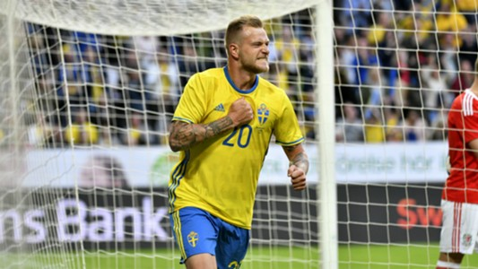 John Guidetti of Sweden scores the decisive goal against Wales to win 3-0