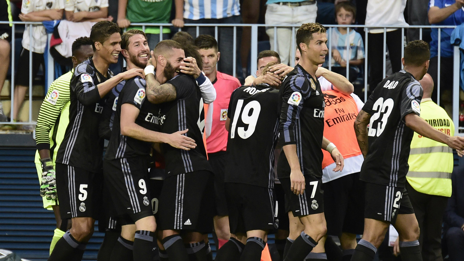 Real Madrid celebrate Malaga