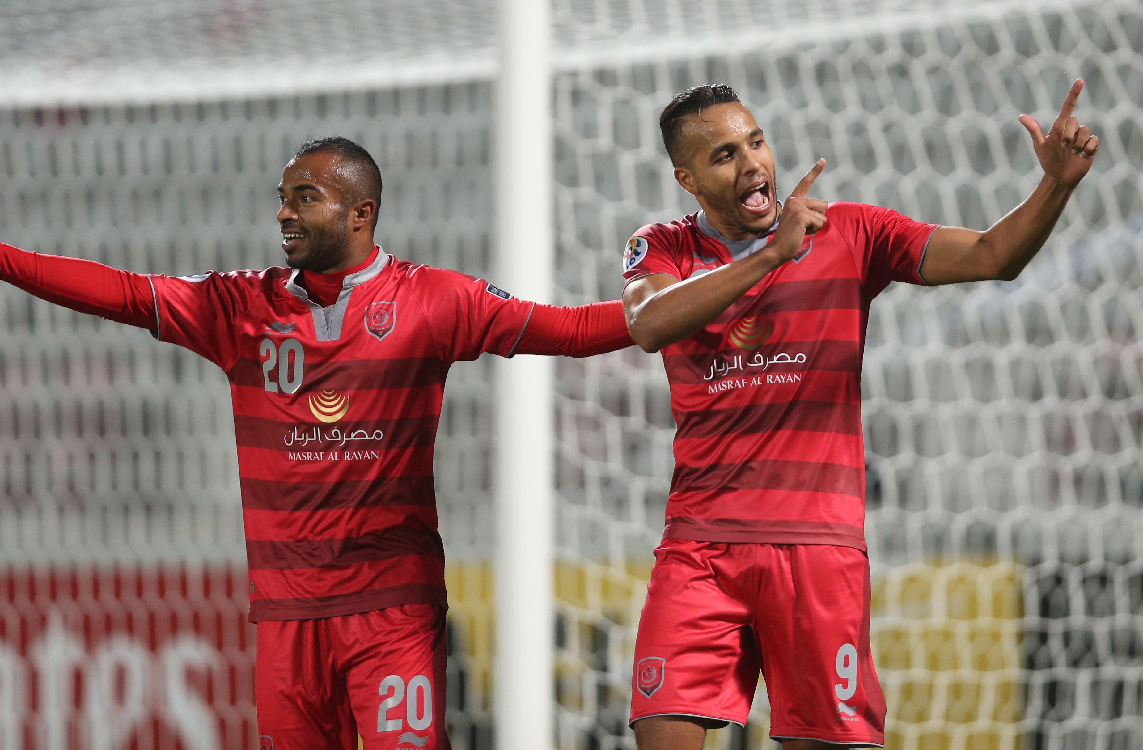 Qatar's Lekhwiya players Ali Hassan Afif (L) and Youssef El-Arabi celebrate