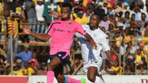 Phathutshedzo Nange of Black Leopards is challenged by Sibusiso Hadebe of Stellenbosch