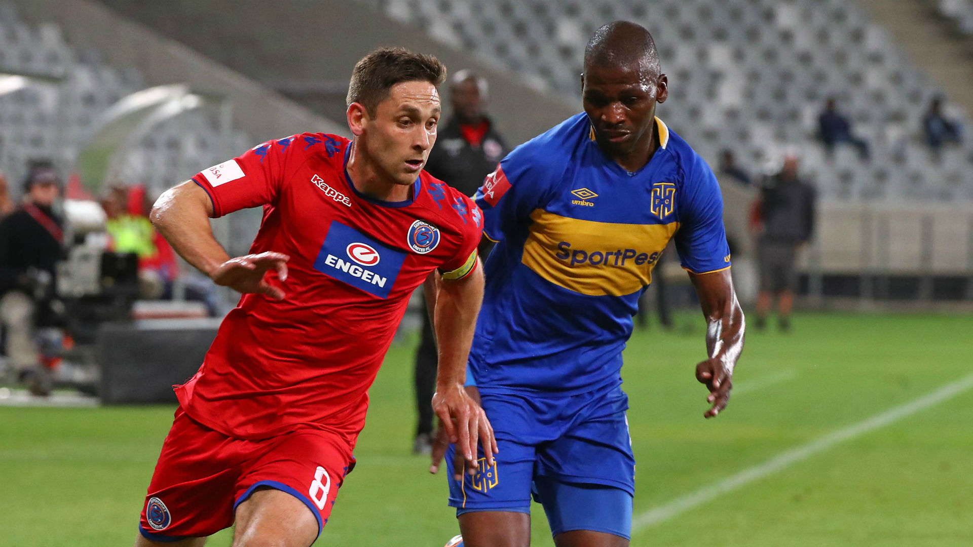 Dean Furman of Supersport United evades challenge from Thamsanqa Mkhize of Cape Town City, April 2018
