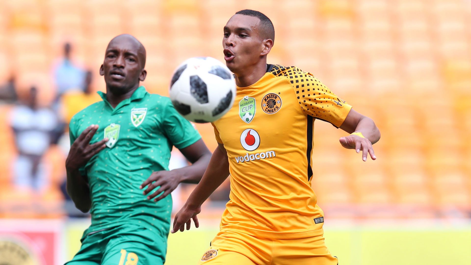 Ryan Moon of Kaizer Chiefs challenged by Lehlohonolo Nonyane of Golden Arrows