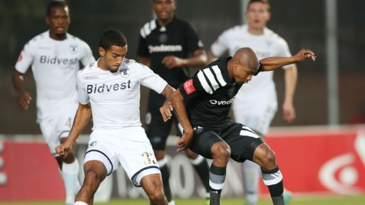 Thabo Qalinge of Orlando Pirates challenged by Reeve Frosler of Bidvest Wits