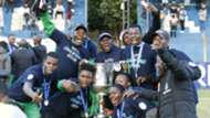 Francis Mustafa and Gor Mahia players with KPL trophy.