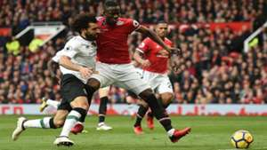 Mohamed Salah of Liverpool vies with Manchester United's defender Eric Bailly