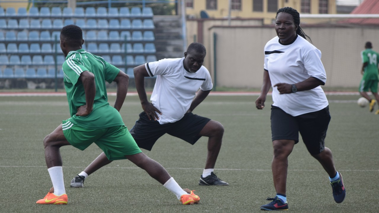 UAM Tillers striker Ebuka David and coach Priscilla Vande - HIFL Nigeria